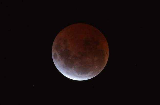 A lunar eclipse is seen from Melbourne, Australia, on Saturday, 04 April 2015. A total lunar eclipse occurs when the moon on its way around the Earth moves through the planet's shadow cast by the sun in opposing position. EPA/DAVID CROSLING AUSTRALIA AND NEW ZEALAND OUT