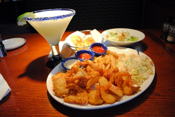 "1) Red Lobster's ""Create Your Own Combination"" (2,710 calories) For CSPI's Create Your Own Combination at Red Lobster, they picked three shrimp dishes (Parrot Isle Jumbo Coconut, Walt's Favorite, and Linguine Alfredo). With french fries as the side, Caesar as the salad, and just one Cheddar Bay Biscuit, the total came to 2,710 calories, 37 grams (two days' worth) of sat fat, and 6,530 mg (a four day supply) of sodium. IMAGE: CSPI website"