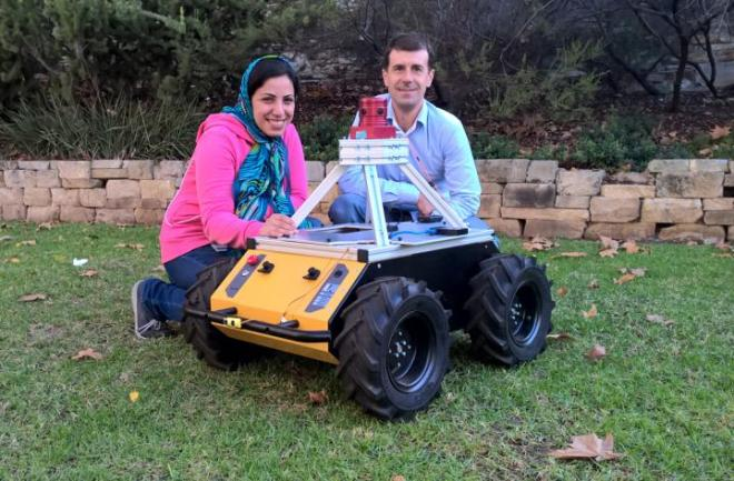 UNIVERSITY OF ADELAIDE PH.D. STUDENT ZAHRA BAGHERI AND SUPERVISOR PROFESSOR BENJAMIN CAZZOLATO (SCHOOL OF MECHANICAL ENGINEERING) WITH THE ROBOT UNDER DEVELOPMENT. CREDIT: THE UNIVERSITY OF ADELAIDE