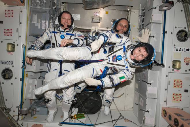 NASA astronaut Terry Virts (left) Commander of Expedition 43 on the International Space Station along with crewmates Russian cosmonaut Anton Shkaplerov (center) and ESA (European Space Agency) astronaut Samantha Cristoforetti on May 6, 2015 perform a checkout of their Russian Soyuz spacesuits in preparation for the journey back to Earth. Credits: NASA