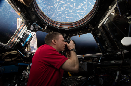 (05/31/2015) --- Expedition 43 Commander and NASA astronaut Terry Virts is seen here in the International Space Station's Cupola module, a 360 degree Earth and space viewing platform. The module also contains a robotic workstation for controlling the station's main robotic arm, Canadarm2, which is used for a variety of operations including the remote grappling of visiting cargo vehicles. (Flickr: nasa2explore)