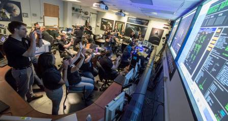 New Horizons Flight Controllers celebrate after they received confirmation from the spacecraft that it had successfully completed the flyby of Pluto, Tuesday, July 14, 2015 in the Mission Operations Center (MOC) of the Johns Hopkins University Applied Physics Laboratory (APL), Laurel, Maryland. Photo Credit: NASA/Bill Ingalls