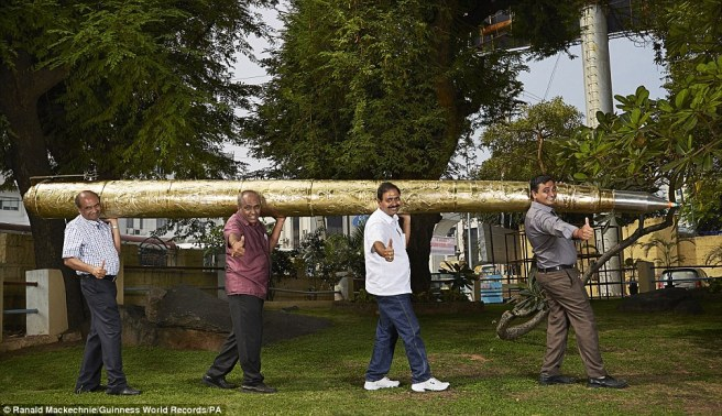 Acharya Makunuri Srinivasa, 56, from Nizamabad, India, features in the Guinness World Records 2016 edition for the longest ballpoint pen at 5.5m (18 ft 0.53 ins) long and weighing 37.23kg (82.08lb 1.24oz).