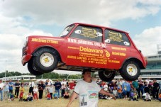 John Evans, 70, faces little competition in the 33 weight-bearing categories for which he repeatedly sets records. Honoured here for 'heaviest car balanced on the head' (a gutted 352 lb Mini for 33 seconds).