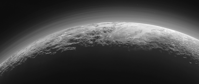 Pluto's Majestic Mountains, Frozen Plains and Foggy Hazes. Credits: NASA/JHUAPL/SwRI