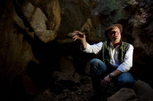 Lee R. Berger, leader of a research team, in the Rising Star Cave near Johannesburg, where over 1,550 fossil elements were found. Credit Naashon Zalk for The New York Times