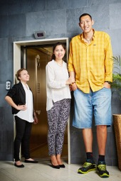 With a combined height of 13 ft 10.72 in (423.47 cm), Sun Mingming, 33, and his wife Xu Yan, 29, of China, claim the title for Tallest married couple, measuring 7 ft 8.98 in (236.17 cm) and 6 ft 1.74 in (187.3 com) respectively.