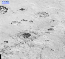 Layered Craters and Icy Plains. Credits: NASA/JHUAPL/SwRI
